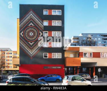 Kreuzberg-Berlin, Mantradala, Artwork by American street artist CRYPTIK on apartment building façade at Bergfriedstraße - Stock Image