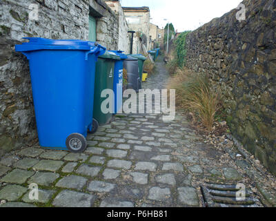 Wheelie bins in back alley UK - Stock Image