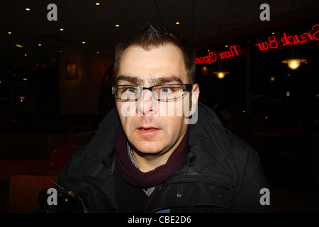 man pulling faces in coral island restaurant. Promenade, Blackpool, Lancashire, FY1 5DW, England, UK - Stock Image