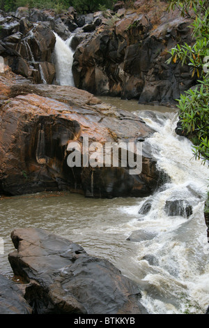 Rock Formations and Waterfall at Lowveld National Botanical Garden, Nelspruit, Mpumalanga, South Africa - Stock Image