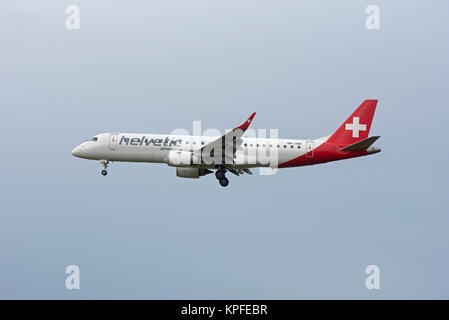 Swiss Air Helvetica Embraer ERJ-190 arriving at RAF Lossiemouth with 30 Swiss Air Force Fast jet Hornet pilots for - Stock Image