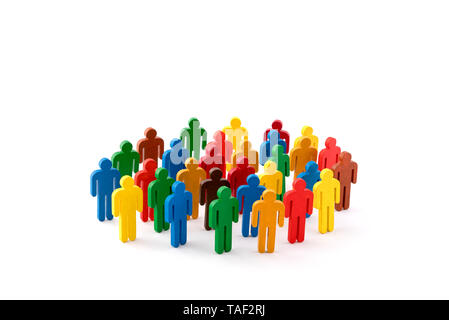 Colorful painted group of people figures on white background - Stock Image