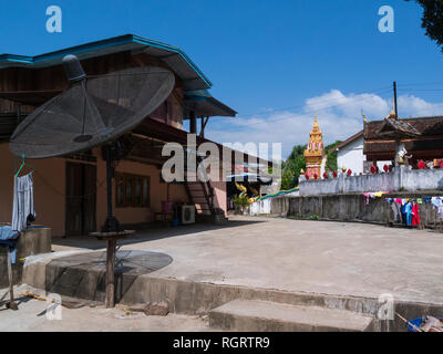 Large satellite dish in whiskey village Ban Xiang Hai Laos Asia rekowned for producing popular rice whiskey called lao-Lao - Stock Image