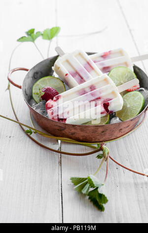 Popsicles made with strawberries and lime - Stock Image