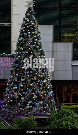 Christmas tree outside a shopping mall, Orchard Road, Singapore. - Stock Image