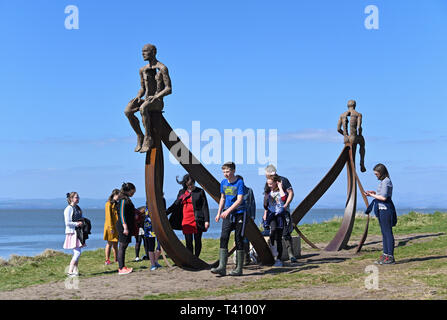 Party of children at 'Ship', metal sculpture by Anna Gillespie, 2019. Half Moon Bay, Heysham, Lancashire, England, United Kingdom, Europe. - Stock Image
