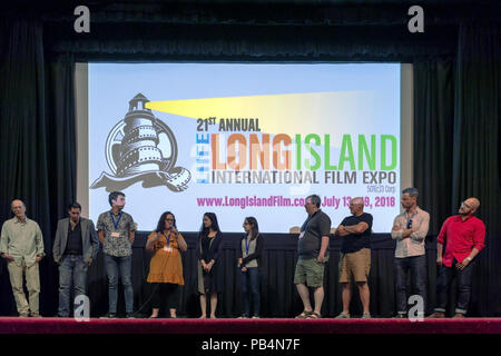 Bellmore, New York, USA. July 18, 2018. After final block of film screenings at LIIFE 2018, the Long Island International Film Expo, filmmakers and actors go on stage for Q&A at Bellmore Movies. SHARA ASHLEY ZEIGER, speaking into mic, is producer and writer of romcom short film JOE; right of her are AJNA JAI, who plays title character in The Adventures of Penny Patterson; and STEPHANIE DONNELLY, writer and director of that film. - Stock Image