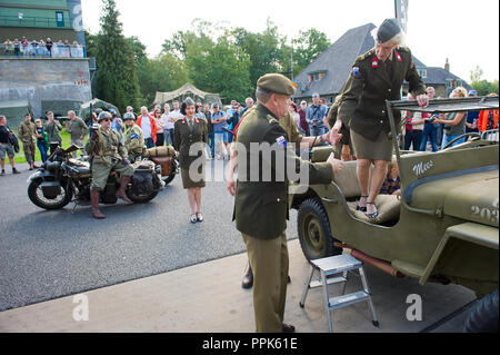 ENSCHEDE, THE NETHERLANDS - 01 SEPT, 2018: A singer from 'Sgt. Wilson's army show' stepping out of a jeep during a military army show. - Stock Image