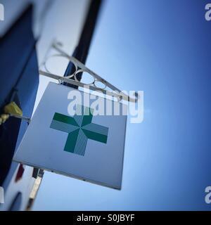 Chemist / pharmacy, green cross sign - Stock Image