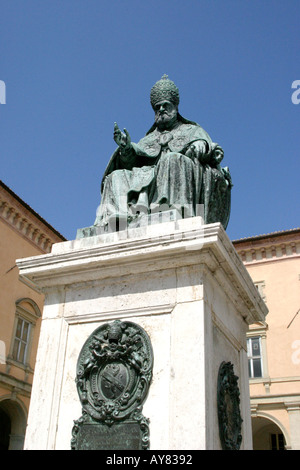 Statue of Pope Sixtus V (1587)in the Piazza Cavour Camerino Le Marche Italy, The Marches ,Piazza,blue sky,strong,dramatic, - Stock Image