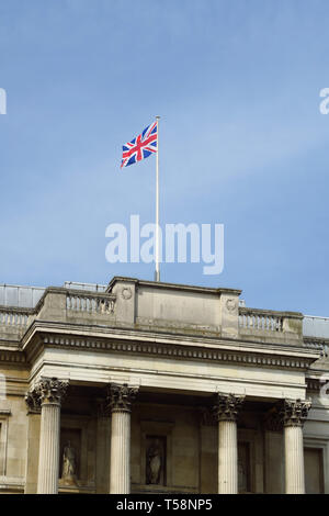 The Union Jack flies proudly above the National Gallery, Trafalgar Square, London - Stock Image