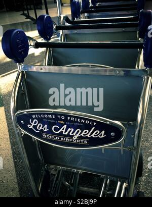 At the international Los Angeles LAX airport luggage carts trolley are available for rent to passengers carrying baggages - Stock Image