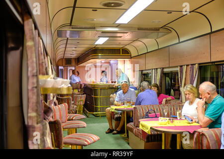 Passengers enjoy a welcome drink in the Lounge of the Premier Classe train departing for Cape Town.  Johannesburg, South Africa - January 17, 2019. - Stock Image