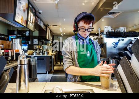 St. Saint Petersburg Florida Starbucks Coffee cafe business inside barista employee working counter woman - Stock Image