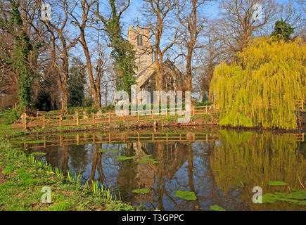 A view of the parish Church of SS Peter and Paul from across the village pond at Halvergate, Norfolk, England, United Kingdom, Europe. - Stock Image