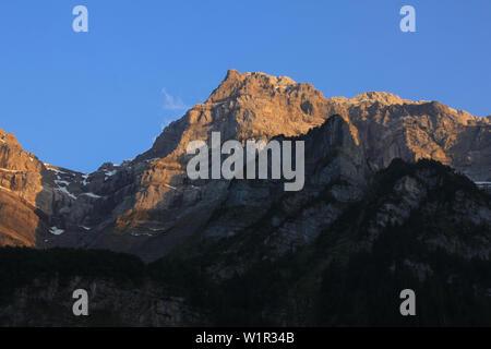 Peak of Mount Glaernisch at sunset, Switzerland. - Stock Image