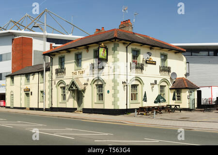 The Turf Pub next to the Wrexham football stadium North Wales known as the Racecourse Ground. The original building was built between 1840 and 1844 - Stock Image