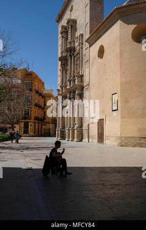 Man playing guitar outside Carmen Church and Convent, Plaza del Carmen, Barrio Del Carmen, Valencia, Spain - Stock Image