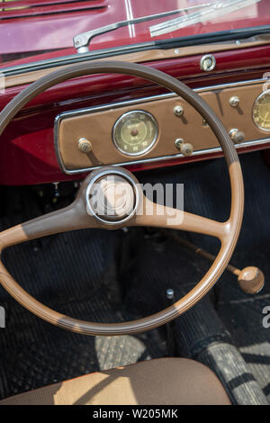 Steering wheel and dashboard of a vintage Fiat car - Stock Image