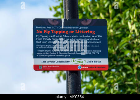 Sign indicating CCTV monitoring and warning of penalties for Fly tipping or Littering in Redcar and Cleveland North Yorkshire - Stock Image
