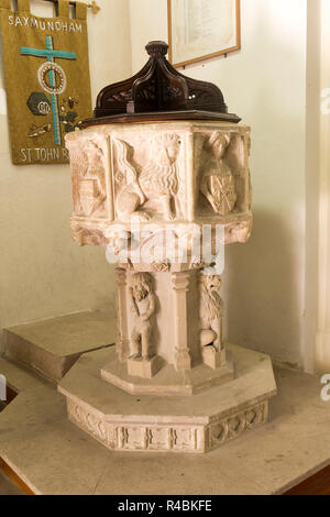 Fifteenth century stone font church of Saint John, Saxmundham, Suffolk, England, UK - Stock Image