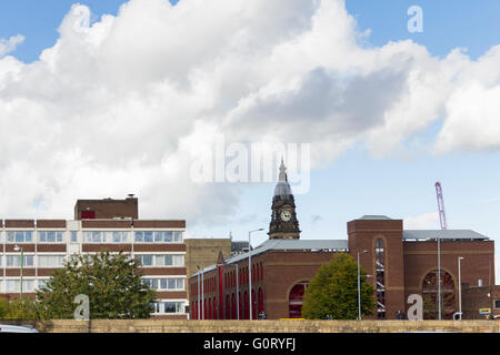 Elizabeth House and the Octagon car park form the skyline to the south of Bolton town hall in the town centre. - Stock Image