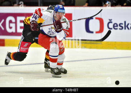 Karlovy Vary, Czech Republic. 18th Apr, 2019. Fabio Wagner of Germany, left, and Lukas Rousek of Czech Republic in action during the Euro Hockey Challenge match Czech Republic vs Germany in Karlovy Vary, Czech Republic, April 18, 2019. (CTK Photo/Slavomir - Stock Image