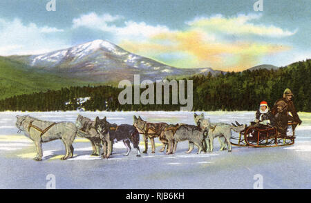 Lake Placid, N.Y., USA - Dog Team on Frozen Mirror Lake - Stock Image