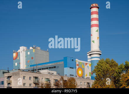 Painted geometric forms pasted on smokestacks on the power plant in the city a project to integrate better in skyline - Stock Image