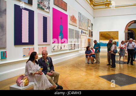one of the Private View days at the 2017 summer exhibitioo with elegant art lovers enjoying a festive glass - Stock Image