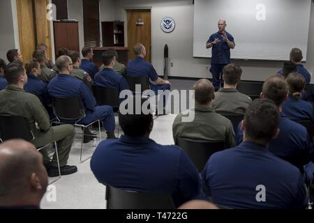 Adm. Charles W. Ray, vice commandant of the Coast Guard, speaks to Coast Guard members during a unit visit at Coast Guard Air Station New Orleans, Thursday, March 14, 2019. Air Station New Orleans supports a wide range of Coast Guard operations to include search and rescue, law enforcement, port security and marine environmental protection. Coast Guard - Stock Image