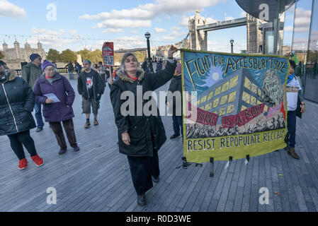 London, UK. 3rd November 2018. At the end of the rally people march around City Hall.Several hundred people, mainly from London's council estates under threat of demolition by Labour London councils came to a protest outside City Hall called by 'Axe the Housing Act'. The protest called for an end to estate demolitions unless  approved by a ballot of all residents, and for public land to be used to build more council homes rather than being turned over to developers to make huge profits from high-priced flats.  Credit: Peter Marshall/Alamy Live News - Stock Image