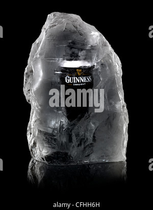 A pint of Guinness encased in a block of ice. - Stock Image