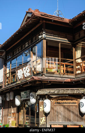Old wooden Japanese building in traditional style, used as a restaurant. Small town, rural Japan. - Stock Image