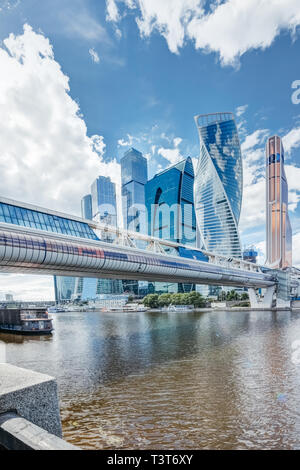 Skyscrapers Moscow city on the Moscow river and Bagration bridge in a cloudy summer day under a blue sky - Stock Image