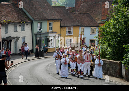 Thaxted Morris Weekend, Thaxted Essex England UK. 2-3 June 2018 The 85th Meeting of the Member Clubs of the Morris Ring hosted by Thaxted Morris Men (who wear red and white stripes) who lead the annual Sunday Morning Procession to Thaxted Church after a busy Saturday of dancing in a dozen local pubs in surrounding villages in North West Essex. Credit: BRIAN HARRIS/Alamy Live News - Stock Image