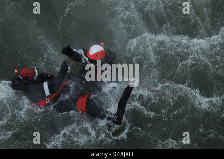 Sailors conduct search and rescue training. - Stock Image