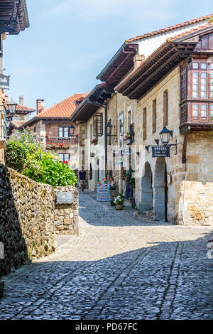 Santillana, Spain - 8th July 2018: Typical street in the town, There are many historic buildings. - Stock Image