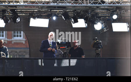 London, UK. 29th Mar, 2019. Jon Snow of Channel 4 News reports outside the Houses of Parliament today . MP's are sitting today to debate leaving the European Parliament on the day it was originally supposed to happen Credit: Simon Dack/Alamy Live News - Stock Image