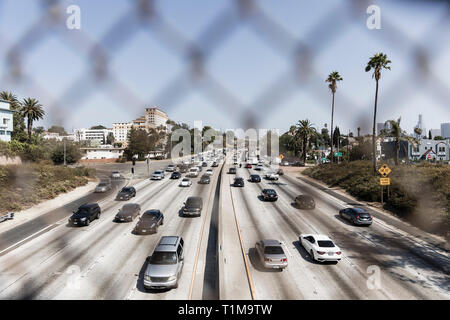 Cars driving along sunny freeway, Los Angeles, California, USA - Stock Image