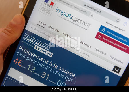 Paris,  France - November 15, 2018 : French tax website on a digital tablet. Reform of the payment of tax at source - Stock Image