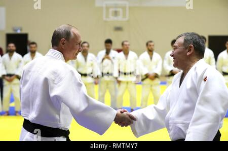 Russian President Vladimir Putin greets the head coach of the Russian judo team Ezio Gamba during judo practice at the Yug-Sport Training Centre February 14, 2019 in Sochi, Russia. - Stock Image