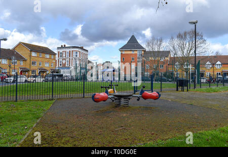 Bermondsey Borough of Southwark London UK - Estate playground with The Bramcote Arms in background which has been converted into flats - Stock Image