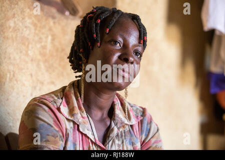 Samba village, Yako Province, Burkina Faso. Salamata Zoundi, 27, mother of two year old triplets at her home. - Stock Image