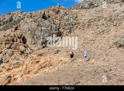 Couple hiking a simple trail to the tidal pools at Grand Fond in St Barts - Stock Image