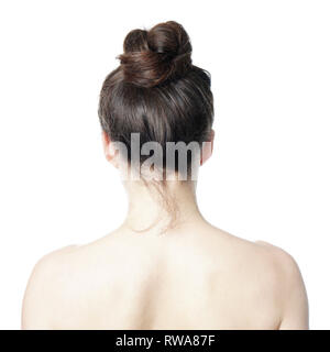 head and shoulder back view of young woman with messy bun - undone hair style fashion trend - Stock Image