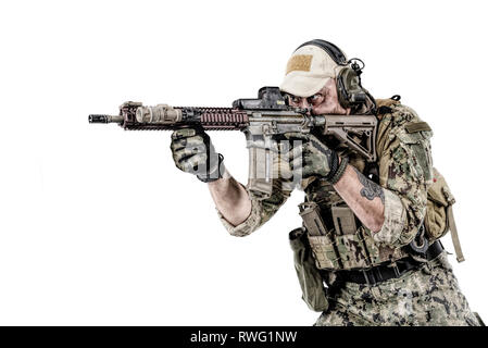 Studio shot portrait of special forces soldier in field uniform with weapon. - Stock Image