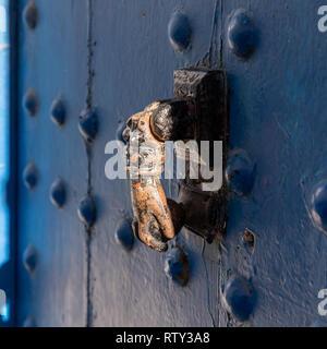 Bronze door knocker in shape of hand in the Rabat kasbah, Morocco - Stock Image