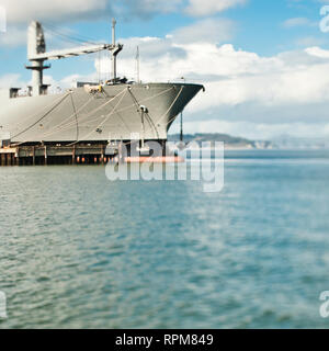 Ship and Loading Dock at a Seaport - Stock Image