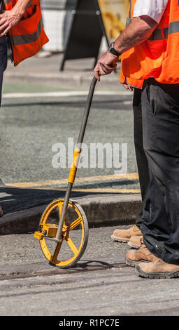 Surveyors With Measuring Wheel - Stock Image